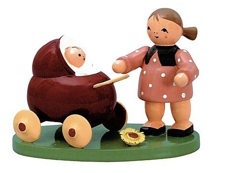 Blumenkind mit Puppenwagen