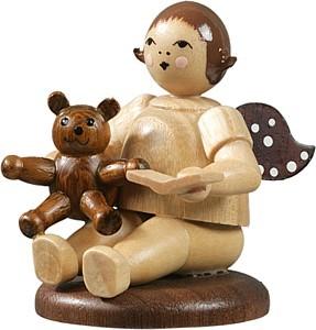 Engel sitzend mit Teddybär / natur
