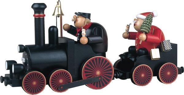 Lokführer und Weihnachtsmann mit Eisenbahn