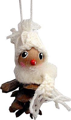 Zapfenmännchen mit weißer Bommelmütze und Schal