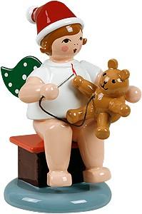 Engel sitzend mit Teddybär