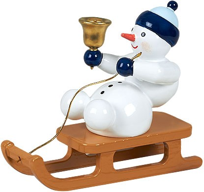 Schneemann - mit Glocke auf Schlitten sitzend