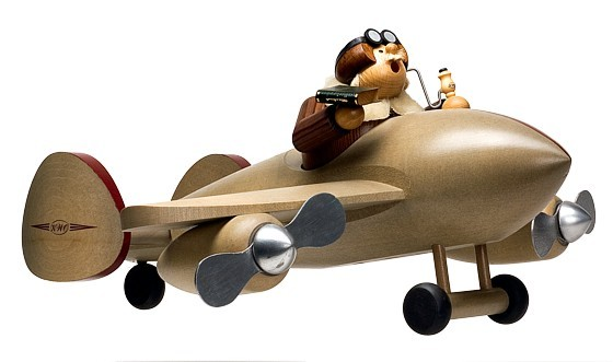 Kantenhocker Pilot mit Flugzeug