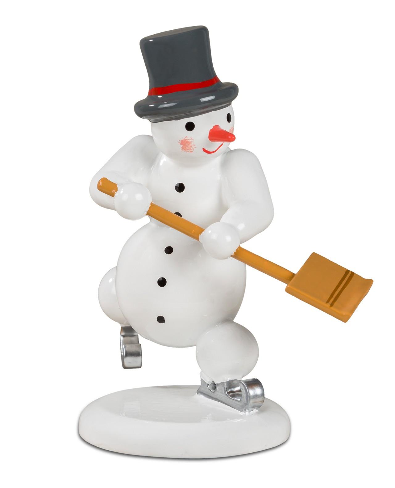 Schneemann - tanzend mit Schneeschieber
